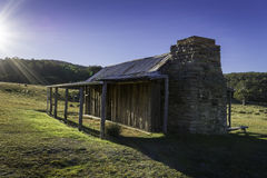 Historic hut with sunbeams Stock Photos