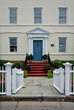 Historic inn front with white fence and garden Royalty Free Stock Image