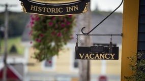 Historic inn and vacancy sign Stock Images
