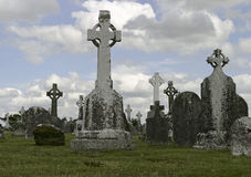 Historic Ireland Cemetery. A historic old cemetery in Ireland with Gaelic headstones showing the traditional cross in a circle. Clonmacnoise is situated in Stock Images