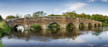White Mill Bridge in Dorset. An historic ironstone bridge over the River Stour at Sturminster Marshall, near Wimborne Minster and reputedly the oldest bridge in Royalty Free Stock Photo