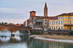 Historic Italian city at river by twilight Royalty Free Stock Photos