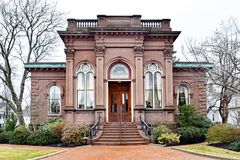 Historic Italianate Bank Building in New England. Historic Italianate bank building in Massachusetts. Early spring. Brownstone. Copper trim. Gold signage Royalty Free Stock Image