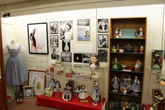 Glass cases and several shelves carrying historic memorabilia covering beloved Wizard of Oz, All Things Oz Museum, Chittenango, Ne. Historic items of interest in stock photography