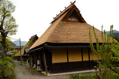Historic Japanese Mountain House. Exterior of historic Japanese mountain house with thatched roof in village in the Kyoto prefecture of Japan Stock Photo