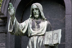 Historic Jesus on the mystery old Prague Cemetery, Czech Republic Stock Images