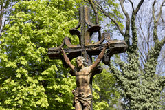 Historic Jesus on the  mystery spring old Prague Cemetery, Czech Republic Stock Photo
