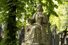 Historic Jesus on the  mystery spring old Prague Cemetery, Czech Republic Royalty Free Stock Image