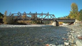 Tulameen River, Kettle Valley Rail Bridge, dolly shot 4K UHD. The historic Kettle Valley Rail Bridge #6 over the Tulameen River. Now part of the Trans Canada stock footage