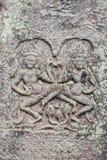 Historic Khmer bas-relief showing dancing Hindu godesses at Bayo Stock Photo