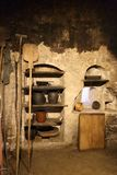 Historic kitchen with old dishes. In the wall recess Stock Images