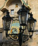Historic lamp and astronomical clock Stock Photo