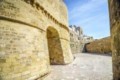 Historic landmarks in Otranto, Apulia, Italy. Medieval castle and Alfonsina Gate in Otranto, Apulia, Italy Royalty Free Stock Images