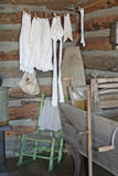 Historic Laundry Room. This is a view of the interior of a log cabin with laundry hanging over an old washer Royalty Free Stock Photography