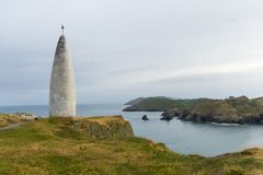 Historic lighthouse in baltimore bay ireland with cliffs and atlantic stock image