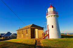 Historic lighthouse and cottage Stock Photography