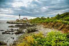 Stormy seas and the Portland Head Light. The historic lighthouse stands as a beacon on the coast of Cape Elizabeth, warning sailors of the craggy shoreline stock photos