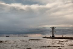 Historic Lighthouse windmill Stawa Mlyny, Swinoujscie, Poland. Royalty Free Stock Images