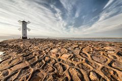 Historic Lighthouse windmill Stawa Mlyny, Swinoujscie, Poland. Stock Image