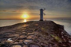 Historic Lighthouse windmill Stawa Mlyny, Swinoujscie, Poland. Royalty Free Stock Image