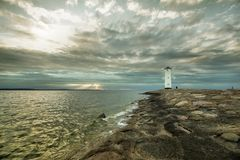 Historic Lighthouse windmill Stawa Mlyny, Swinoujscie, Poland. Royalty Free Stock Photo