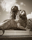 Historic Lion Sculpture in Sepia royalty free stock images