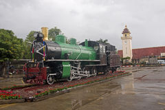 The historic locomotive in front of the railway station Stock Images