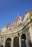 Historic London. Admiralty Arch decorated with White Ensign flags in central London, England, United Kingdom Royalty Free Stock Photography
