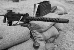 Historic machine gun with bullets over the sandbags Stock Photography