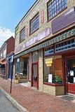 Historic Main Street in Warrenton Virginia. With storefronts made of red and yellow bricks, a chair in the front, and a sign advertising food stock photos