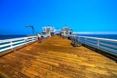 Historic Malibu Pier. Malibu, CA, United States - August 7, 2018: historic Malibu Pier, a Southern California icon in the heart of California`s surf culture and stock photo