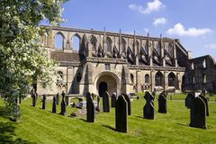 Picturesque Malmesbury Abbey. Historic Malmesbury Abbey in spring sunshine, Wiltshire, UK Stock Image