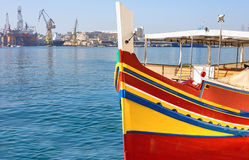 Historic Maltese boat in Grand Valetta Bay in Malta Stock Photo