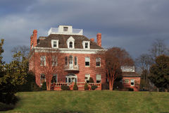 Historic Mansion. Historical Mansion with red brick and skyline royalty free stock photos