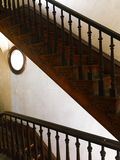 Historic mansion stairs in Italianate home. 1900 century staircase, antique, old house, fixer upper, ship window Royalty Free Stock Photo