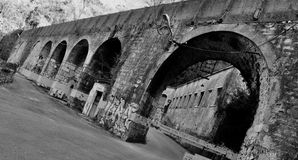 Historic medieval architecture with arches in Rijeka. Old castle wall in black and white color made of stone stock photo