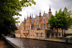 Historic medieval buildings along a canal in Bruges, Belgium Stock Image