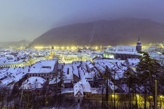 Historic medieval city of Brasov, Transylvania, Romania, in the winter. December 6th, 2015. The Black Church to the right and the Council square to the left Stock Photo