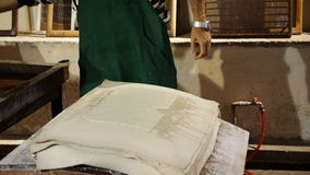 Historic method of paper making stock footage