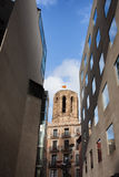 Historic and Modern Architecture in Barcelona. Tower of Basilica of Santa Maria del Pi framed by modern buildings in Barcelona, Catalonia, Spain royalty free stock photography