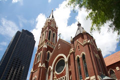 Historic and modern building in Dallas. Old red church and modern building in downtown Dallas,Texas Stock Image
