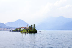 Historic monastery on Isola San Giulio on Italian lake Orta in Piedmont on a hazy day Stock Photography