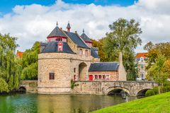Historic monument of Bruges. Ezelpoort or donkeys gate. A gate to enter the city. stock photos
