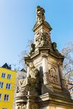 Historic monument of a fountain in Cologne. Historic monument of a fountain on the Old Market Square in Cologne, Germany Stock Images