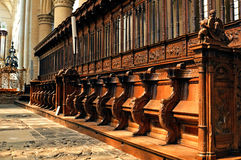 Historic and monumental church bench Stock Images