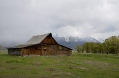 Historic Mormon Row, Grand Teton National Park, Jackson Hole valley, Wyoming, USA. NIn the back Grand Teton Mountain Stock Image