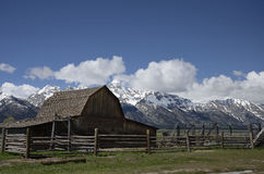 Historic Mormon Row, Grand Teton National Park, Jackson Hole valley, Wyoming, USA. NIn the back Grand Teton Mountain Stock Photography