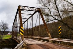 Historic Moser Road Truss Bridge - Autumn Splendor - Somerset County, Pennsylvania. An autumn view of the historic Moser Road truss bridge tucked away in the royalty free stock photos