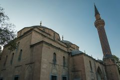 Historic mosque photographed from lower angle Mısri camii Afyon, Turkey. Clear sky background stock image