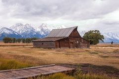 Historic Moulton Barn with snow-covered mountains in Moose, Wyoming royalty free stock photography